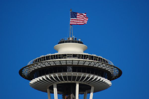An American flag flys atop the Seattle Space Needle thumbnail