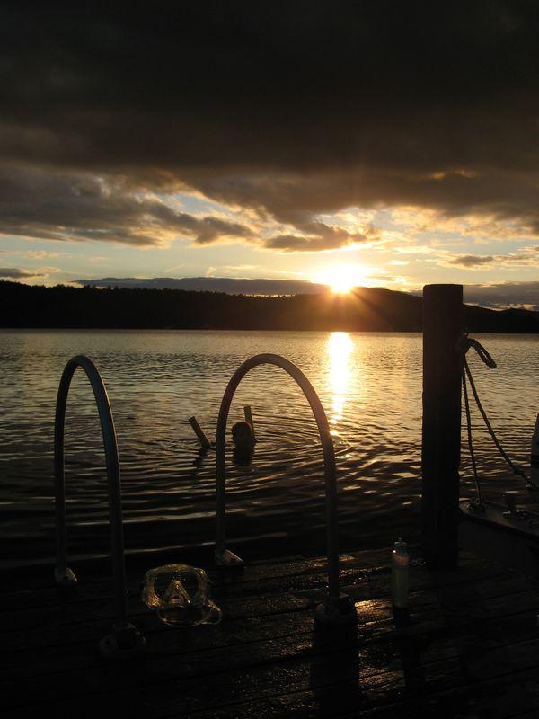 Boy swimming on Bottle Lake, Maine. thumbnail