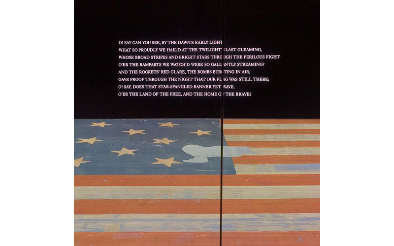The first stanza of the national anthem is projected prominently on the wall above the Star-Spangled Banner in the museum. (NMAH)