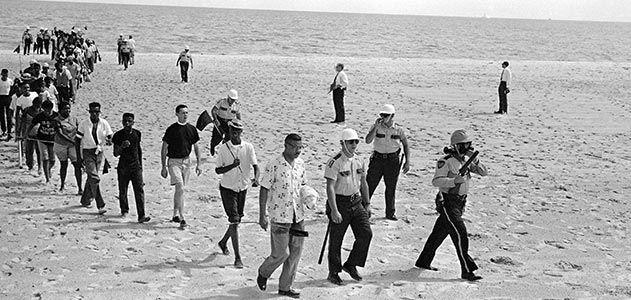 Black and white demonstrators at Biloxi beach