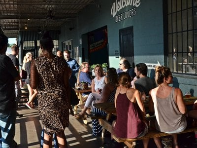 On a summer Friday, people gather at O'Connor Brewing Co. in Norfolk, Virginia.
