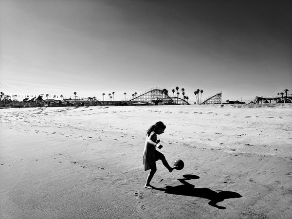 Child plays on deserted Boardwalk beach thumbnail