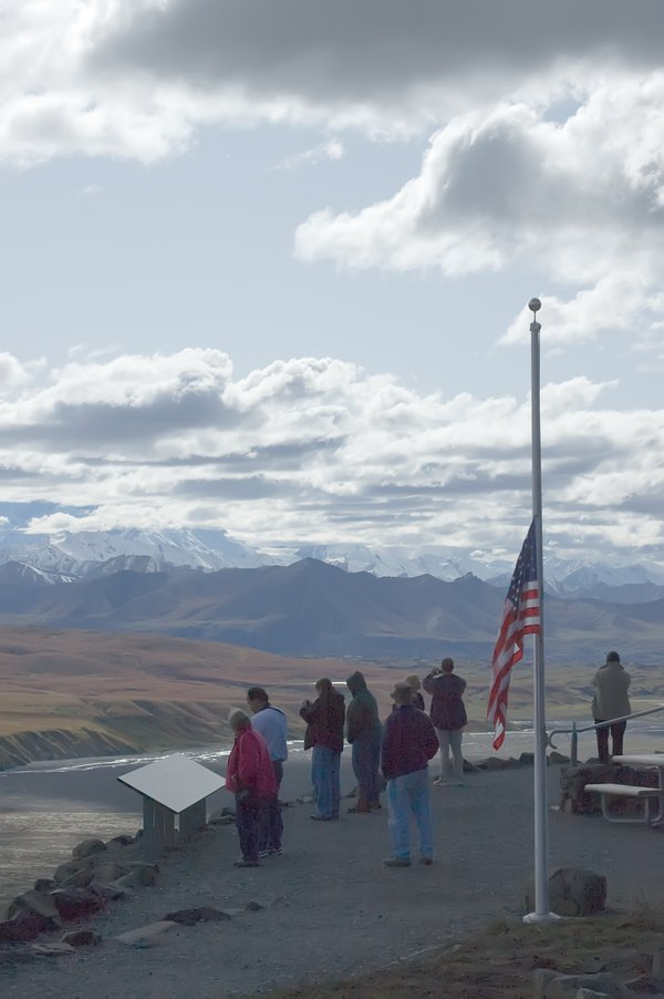 Tourists at Mt. McKinley; flag at half-mast in remembrance of Senator Edward Kennedy. thumbnail