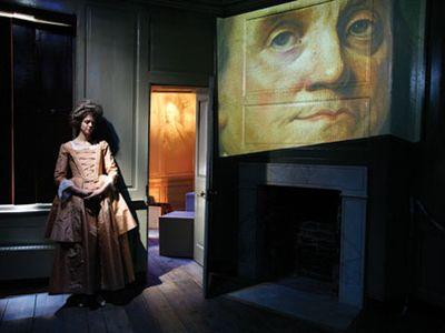 Actress Meg Faragher as Polly Stevenson Hewson, the daughter of Franklin's landlady, guides visitors through a high-tech presentation dramatizing Franklin's London years.