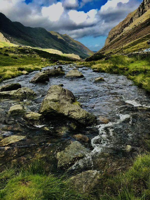 A fastflowing river passing through beautiful hills thumbnail