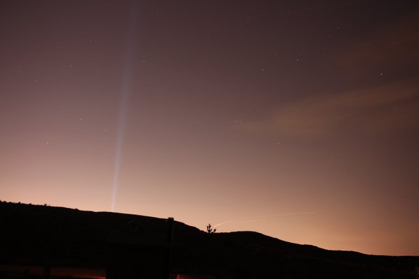 A Las Vegas spotlight seen from the desert thumbnail
