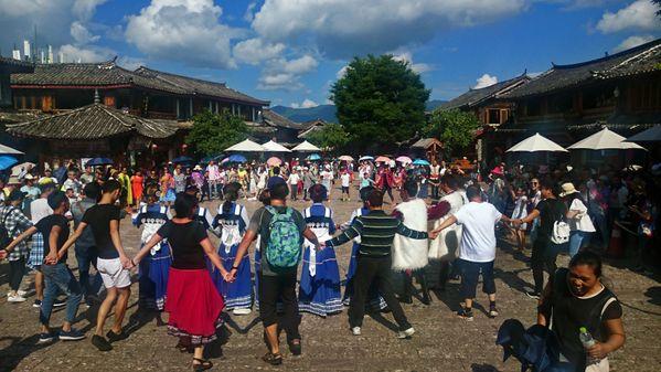 enjoying dance together at Lijiang thumbnail