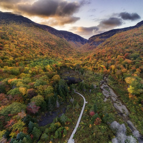 Sunset over fall colors in Smugglers Notch valley thumbnail