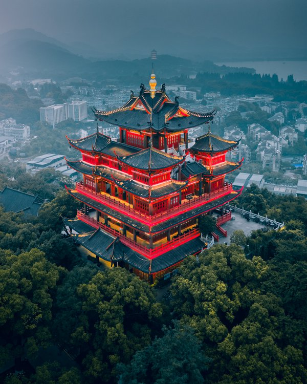 Temple on the hill with west lake on background in Hangzhou