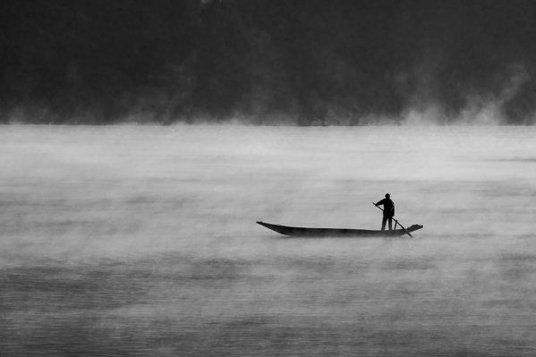 A lonely boat in the fog thumbnail