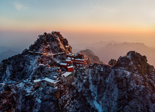 The summit of Wudang Mountain in China is bathed in the golden sunrise.
