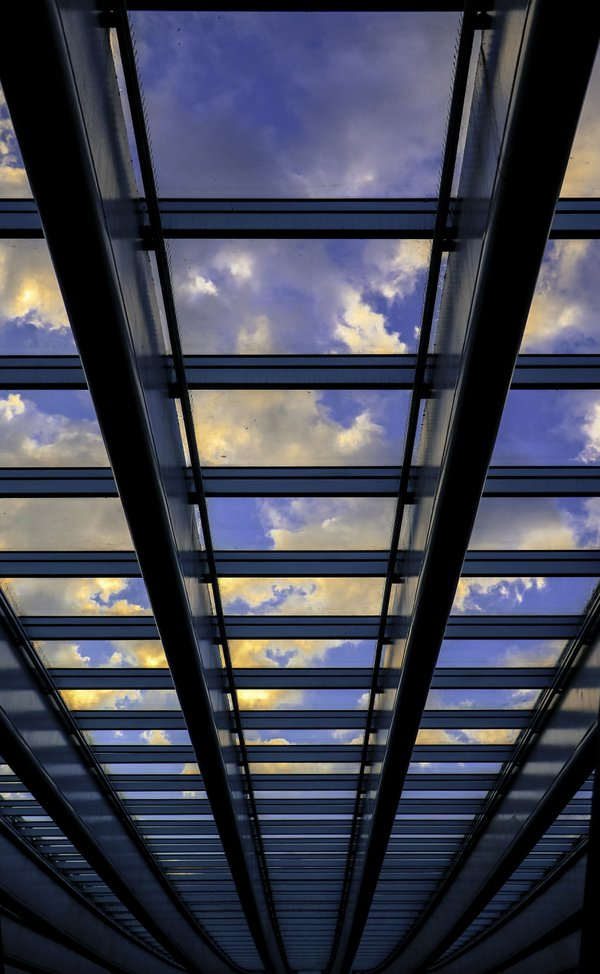 Twilight Sky Through A Train Station Ceiling thumbnail