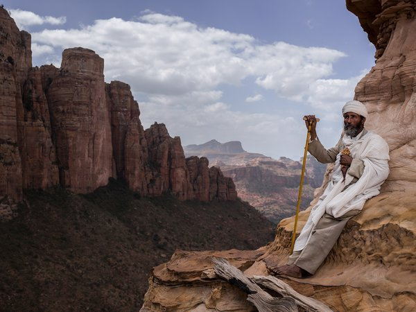 Ethiopia's 'church in the sky' is arguably the most inaccessible place of worship on earth, perched on top of a vertical spire of rock and 200m drops on all sides. The monolithic church, located in northern Ethiopia in the Tigray region, is 2,600m high and must be climbed on a vertical rock with bare feet to reach it, making you wonder how families grit it out to visit the church for Sunday services. This is the most extraordinary place I've ever been and this priest is one of the most incredible subjects I've been lucky enough to shoot.