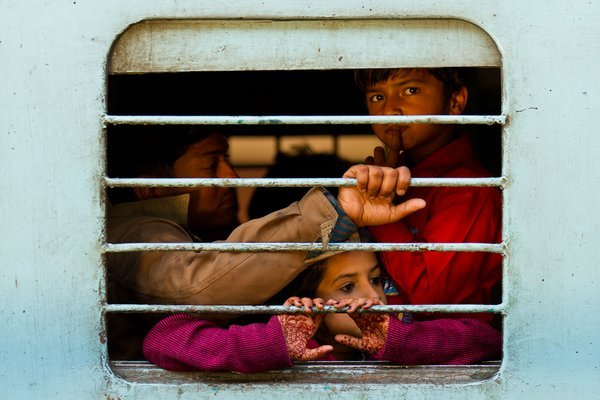 The family was packed in the poor-conditioned cabin of a train to Jodphur. This is a norm for long distance travel in India. thumbnail