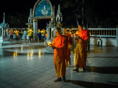 Monks lead a candlelight procession around the ordination hall during Vesak celebrations in rural Nakhon Nayok, Thailand.