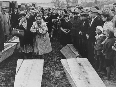 Women grieving over the coffins of those killed in the Kielce pogrom as they are transported to the burial site in the Jewish cemetery.