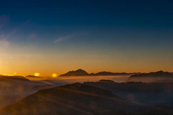Sun Rays Kissing Misty Mountain tips thumbnail