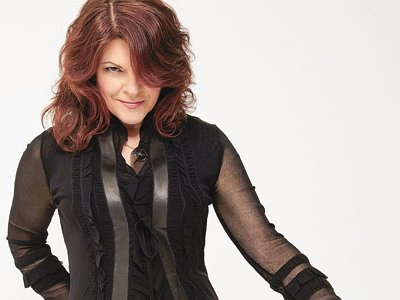 Rosanne Cash, the daughter of Johnny Cash, is not a country and western singer in the tradition of her famous father. She's American music's theoretical physicist of love.