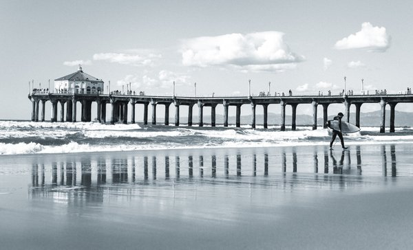 A surfer walking on Manhattan Beach thumbnail