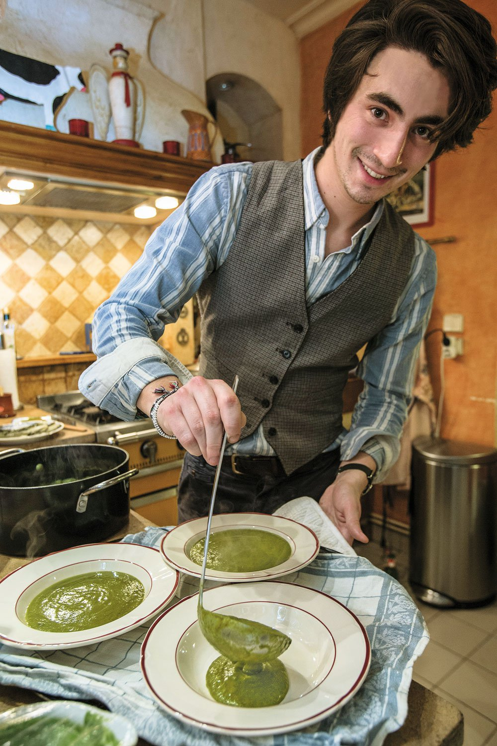 Alexis Marot spoons out watercress soup for the meal's first course. (Owen Franken)