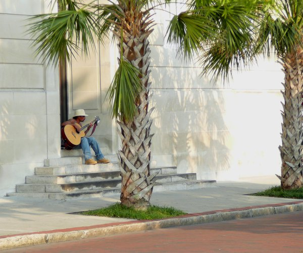 A sidewalk guitarist making the most of a sunny day in historic downtown Wilmington. thumbnail
