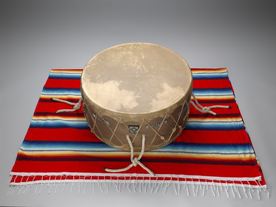 Drum used by Native American soldiers during Operation Iraqi Freedom, 2007 and 2008. 27/167. The drum was also used in a Cheyenne Soldier Dance held for Cody Ayon (Southern Cheyenne) in 2010 when he returned to the United States. Mr. Ayon gave the drum to the museum in 2018. (National Museum of the American Indian)