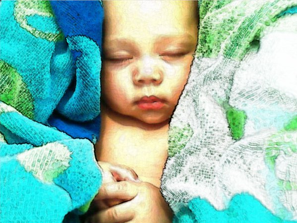 Baby sleeping after a day at the pool. thumbnail