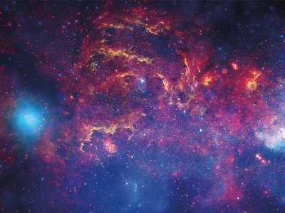 The central region of our Milky Way is a bustling galactic downtown with a supermassive black hole at its hub.
