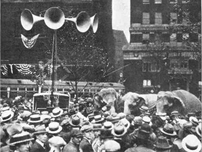 """Crowd outside the 1924 Republican National Convention in Cleveland listen to speeches broadcast from inside the hall via an early """"public address system."""""""