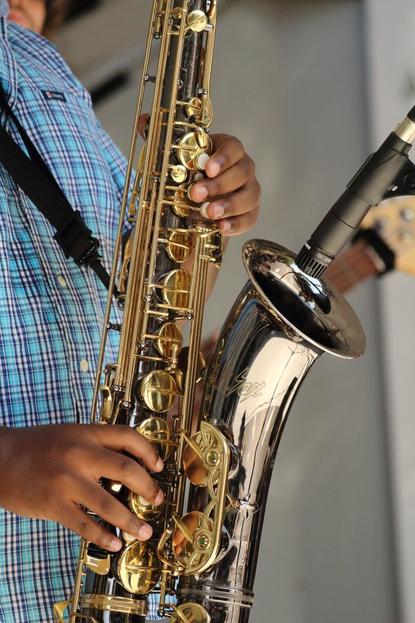 An African American musician performing jazz on the saxophone thumbnail
