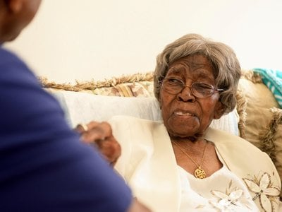 Roosevelt Patterson greets his grandmother, Hester Ford, during her 111th birthday party. Ford was either 115 or 116 when she died on Saturday, April 17, 2021.