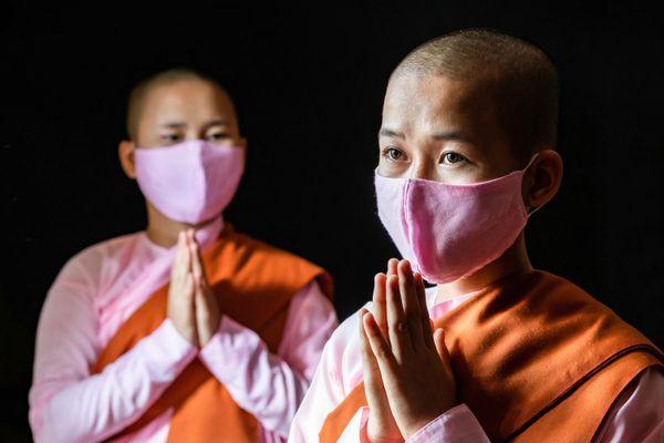 Face mask and young buddhist nuns at monastery thumbnail