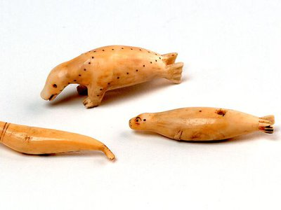 """These walrus ivory carvings were collected in the mid-1880s. They were featured in a catalogue for the exhibition """"Looking Both Ways: Heritage and Identity of the Alutiiq People"""" at the Smithsonian's National Museum of Natural History in 2003."""
