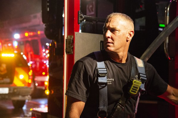 Firefighter working on a fire scene thumbnail