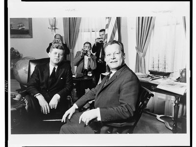 President John F. Kennedy sits in the Oval Office with West Berlin's Mayor Willy Brandt in 1961.  The Berlin Wall would be erected only a few months later.