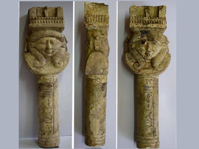 A limestone pillar depicts the goddess Hathor, who was worshipped at the temple.