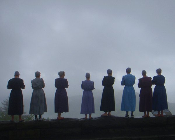 Newfound Gap, Smokey Mountain National Park, a group of young Menonite women on the wall at the scenic overlook. thumbnail