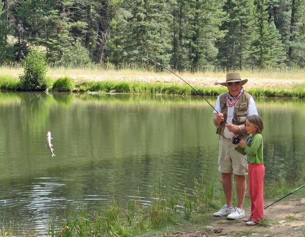 PaPa and Quinn catch a trout thumbnail
