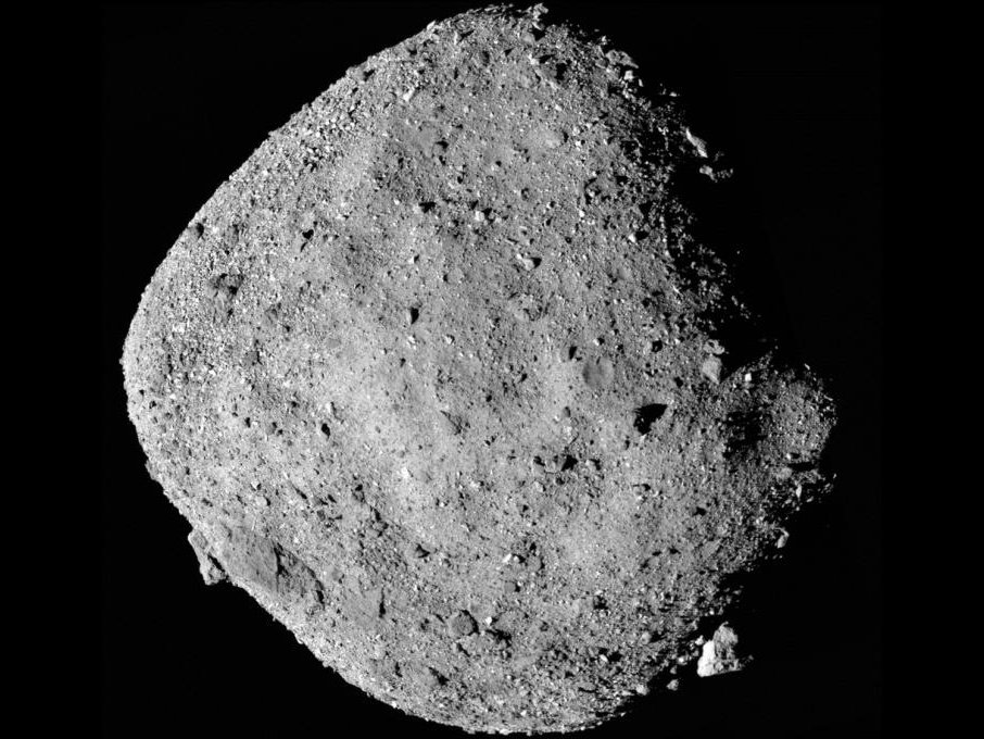 A composite image of asteroid Bennu with a shadow on its right