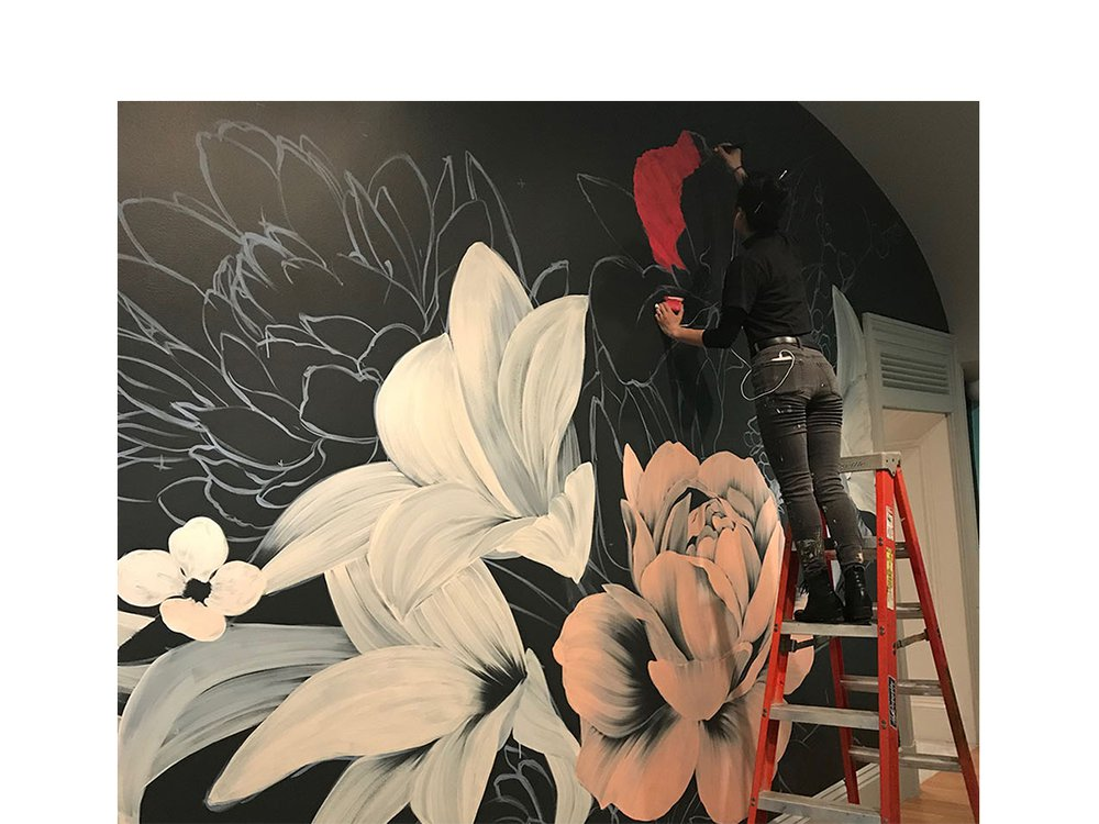 The artist Louise Jones, known as Ouizi, working on Adaptation Nocturne.