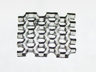 This honeycomb structure was printed in fused silica glass.
