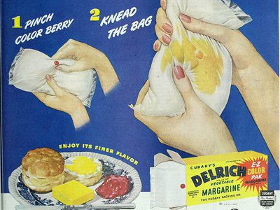 """This 1948 ad for Cudahy's Delrich brand of margarine uses a """"color berry"""" to color its margarine yellow."""