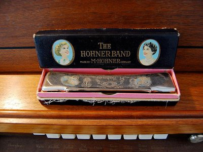 A standard 10-hole Hohner harmonica.