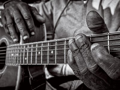 """The worn hands and nubby fingernails of Bentonia, Mississippi, bluesman Jimmy """"Duck"""" Holmes reflect his years of experience. Holmes is one of the last bluesmen who play a style known as Bentonia blues."""