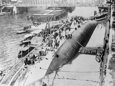 """One of the greatest inland waterways disasters in the history of the United States took place in the Chicago River, Chicago, Ill., July 24, 1915, when the steamship Eastland capsized with a loss of near 850 lives. The photo shows the ill-fated ship after it had turned """"turtle."""""""