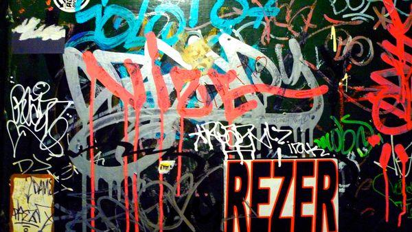 Grafitti on a bathroom door thumbnail