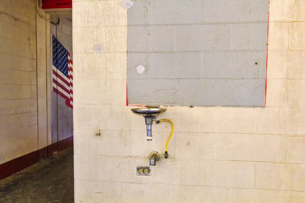 A water fountain and American flag  in a former barrack building at the Fort Ord US Army post thumbnail