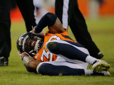 Denver Bronco player David Bruton grabs his head on the field after a reported concussion. Many patients with such head injuries suffer symptoms months after their diagnosis, even though their brains look healthy on CT scans.