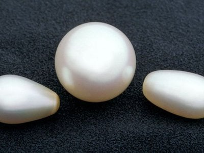 Smooth pearls in the shape of orbs and ovals are usually created by bivalves, like mussels, in pearl farms. As with all gems, the less blemishes they have, the more valuable they are.