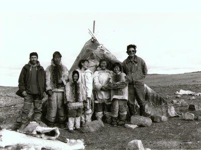 "Members of Isuma (Left to right: Norman Cohn, Pauloosie Qulitalik, Lizzie Qulitalik, Mary Qulitalik, Rachel Uyarashuk, Jonah Uyarashuk, Zacharias Kunuk) on the set of ""Nunaqpa (Going Inland),"" 1990."